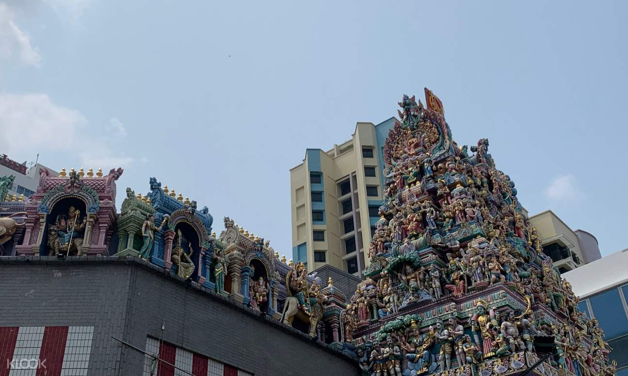 statues along the roof of a building depicting Hindu dieties
